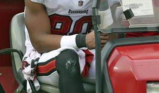 Tampa Bay Buccaneers tight end O.J. Howard (80) reacts as he leaves the field after getting injured against the Los Angeles Chargers during the second half of an NFL football game Sunday, Oct. 4, 2020, in Tampa, Fla. (AP Photo/Mark LoMoglio)