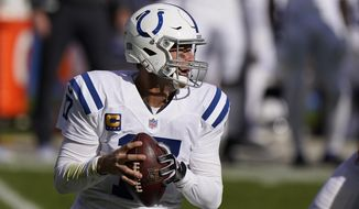 Indianapolis Colts quarterback Philip Rivers (17) looks to throw during the first half of an NFL football game against the Chicago Bears, Sunday, Oct. 4, 2020, in Chicago. (AP Photo/Nam Y. Huh)