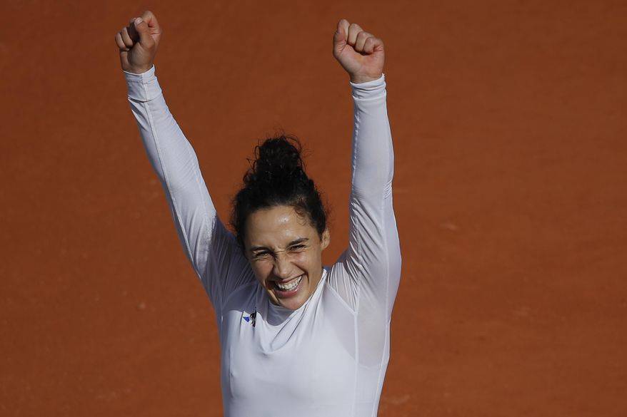 Italy's Martina Trevisan celebrates winning the fourth round match of the French Open tennis tournament against Netherlands' Kiki Bertens in two sets, 6-4, 6-4, at the Roland Garros stadium in Paris, France, Sunday, Oct. 4, 2020. (AP Photo/Christophe Ena)