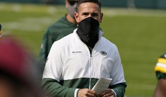 Green Bay Packers head coach Matt LaFleur walks off the field after an NFL football game against the Detroit Lions Sunday, Sept. 20, 2020, in Green Bay, Wis. The Packers won 42-21. (AP Photo/Morry Gash)