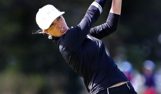 Mel Reid hits from the fourth tee during the final round of the Shoprite LPGA Classic golf tournament, Sunday, Oct. 4, 2020, in Galloway, N.J. (AP Photo/Noah K. Murray)