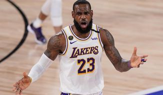 Los Angeles Lakers' LeBron James (23) reacts after no foul was called against the Miami Heat during the second half in Game 3 of basketball's NBA Finals, Sunday, Oct. 4, 2020, in Lake Buena Vista, Fla. (AP Photo/Mark J. Terrill)