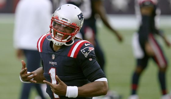 New England Patriots quarterback Cam Newton celebrates after defeating the Las Vegas Raiders in an NFL football game, Sunday, Sept. 27, 2020, in Foxborough, Mass. (AP Photo/Charles Krupa)  **FILE**