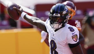 Baltimore Ravens quarterback Lamar Jackson (8) runs into the end zone for a touchdown against the Washington Football Team during the first half of an NFL football game, Sunday, Oct. 4, 2020, in Landover, Md. (AP Photo/Susan Walsh)