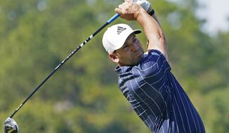 Sergio Garcia watches his drive from the second tee during the final round of the Sanderson Farms Championship golf tournament in Jackson, Miss., Sunday, Oct. 4, 2020. (AP Photo/Rogelio V. Solis)