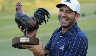 Sergio Garcia, of Spain, holds the Sanderson Farms Championship trophy after winning the PGA golf tournament in Jackson, Miss., Sunday, Oct. 4, 2020. (AP Photo/Rogelio V. Solis)