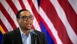 Lewis Ferebee, chancellor of D.C. Public Schools, speaks during a news conference, Thursday, July 30, 2020, in Washington, where it was announced that District of Columbia public schools will be all virtual through Nov. 6. (AP Photo/Jacquelyn Martin) ** FILE **