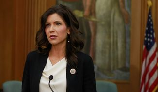 South Dakota Gov. Kristi Noem is basking in a national spotlight after keeping South Dakota open. She's emerged as one to watch for a 2024 run. (Associated Press)