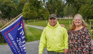 Trump supporters Meg and Rich Schlauch say their way of life is at stake in the presidential election. (Photo by Dave Boyer)