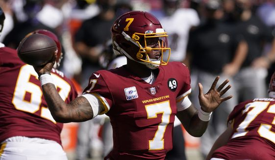 Washington Football Team quarterback Dwayne Haskins (7) tosses a pass during the first half of the Baltimore Ravens Washington Football team NFL football game Sunday, Oct. 4, 2020, in Landover, Md. (AP Photo/Steve Helber)