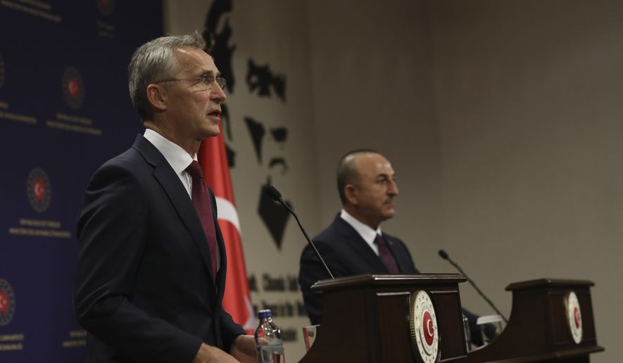 """NATO Secretary-General Jens Stoltenberg, left, and Turkey's Foreign Minister Mevlut Cavusoglu speak to the media after their talks in Ankara, Turkey, Monday, Oct. 5, 2020. Stoltenberg said the 30-country military alliance is """"deeply concerned by the escalation of hostilities """" between Azerbaijan and Armenia and he urged Turkey to help end the fighting. (AP Photo/Burhan Ozbilici)"""
