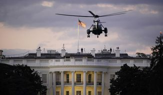 President Donald Trump arrives back at the White House aboard Marine One, Monday evening, Oct. 5, 2020 in Washington, after being treated for COVID-19 at Walter Reed National Military Medical Center. The president's personal physician, Dr. Sean Conley, told reporters on Monday afternoon that Trump is not out of the woods yet, but that there is no care at the hospital that the president cannot get at the White House. (AP Photo/J. Scott Applewhite)