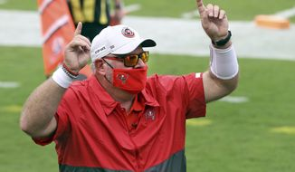 Tampa Bay Buccaneers head coach Bruce Arians celebrates as he leaves the field after an NFL football game against the Los Angeles Chargers Sunday, Oct. 4, 2020, in Tampa, Fla. (AP Photo/Mark LoMoglio)