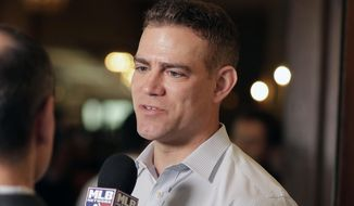 """FILE - In this Nov. 13, 2019, file photo, Chicago Cubs president of baseball operations Theo Epstein speaks at a media availability during the Major League Baseball general managers annual meetings in Scottsdale, Ariz. Epstein appears to be gearing up for one more go-around as the Cubs' president of baseball operations. Epstein said Monday, Oct. 5, 2020, his expectation is the """"status quo"""" when it comes to the team's leadership and anticipates remaining on the job for at least one more season, with his contract set to expire in 2021. (AP Photo/Matt York, File)"""
