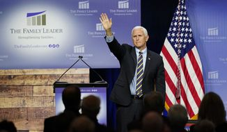 Vice President Mike Pence waves as he leaves the stage after speaking at an event hosted by The Family Leader Foundation Thursday, Oct. 1, 2020, in Des Moines, Iowa. (AP Photo/Charlie Neibergall)