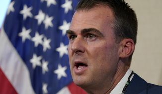 FILE - In this Sept. 22, 2020 file photo, Oklahoma Gov. Kevin Stitt speaks during a news conference in Oklahoma City. The U.S. Environmental Protection Agency has approved a request from Gov. Stitt's administration to allow the state, not tribal nations, to regulate environmental issues in Indian Country.(AP Photo/Sue Ogrocki File)