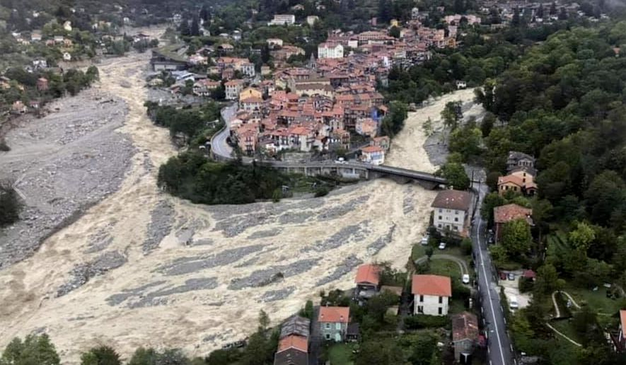 This aerial view provided Sunday, Oct. 4, 2020, by the Alpes Maritimes region fire brigade shows a house keeping a fragile balance on a hill while a rive floods Saturday Oct.3. 2020 near La Vesubie, southern France. French authorities deployed about 1,000 firefighters, four military helicopters and troops to search for at least eight people who were missing after devastating floods hit a mountainous border region with Italy, where at least four people were killed. (SDIS 06 via AP)