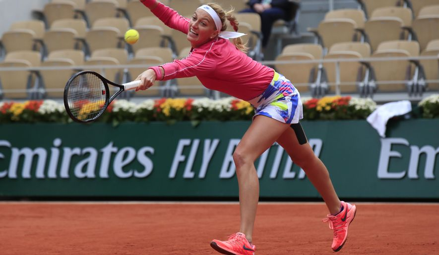 Petra Kvitova of the Czech Republic plays a shot against China's Zhang Shuai in the fourth round match of the French Open tennis tournament at the Roland Garros stadium in Paris, France, Monday, Oct. 5, 2020. (AP Photo/Michel Euler)