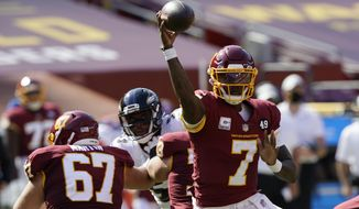 Washington Football Team quarterback Dwayne Haskins (7) works against the Baltimore Ravens during the first half of an NFL football game, Sunday, Oct. 4, 2020, in Landover, Md. (AP Photo/Susan Walsh)
