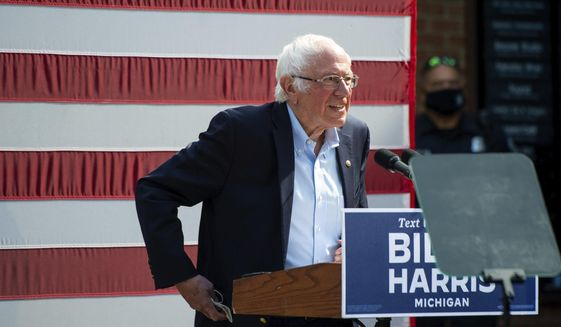 In this file photo, Vermont Sen. Bernie Sanders approaches the stage at Kerrytown Market in Ann Arbor on Monday, Oct. 5, 2020. (Jacob Hamilton/Ann Arbor News via AP)  ** FILE **