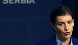 In this photo taken Friday, July 26, 2019, Serbian Prime Minister Ana Brnabic speaks during a press conference in Belgrade, Serbia. Serbia's President Aleksandar Vucic has proposed that current Prime Minister Ana Brnabic stay in office for another four years, paving the way for the formation of a new government more than three months after a parliamentary election. The balloting was the first held in Europe after the outbreak of the new coronavirus and amid a boycott by many opposition groups who said the balloting was not free and fair. (AP Photo/Darko Vojinovic)