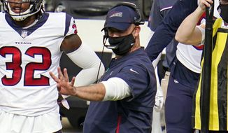Houston Texans head coach Bill O'Brien, center, gives signals from the sideline during the second half of an NFL football game against the Pittsburgh Steelers in Pittsburgh, Sunday, Sept. 27, 2020. (AP Photo/Gene J. Puskar)