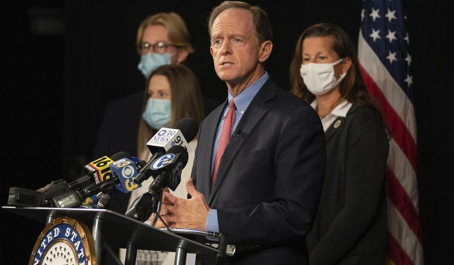Republican U.S. Sen. Pat Toomey, of Pennsylvania, announces he won't seek reelection or run for governor during a news conference with his family, Monday, Oct. 5, 2020 at PPL Public Media Center, in Bethlehem, Pa. (Jessica Griffin/The Philadelphia Inquirer via AP)