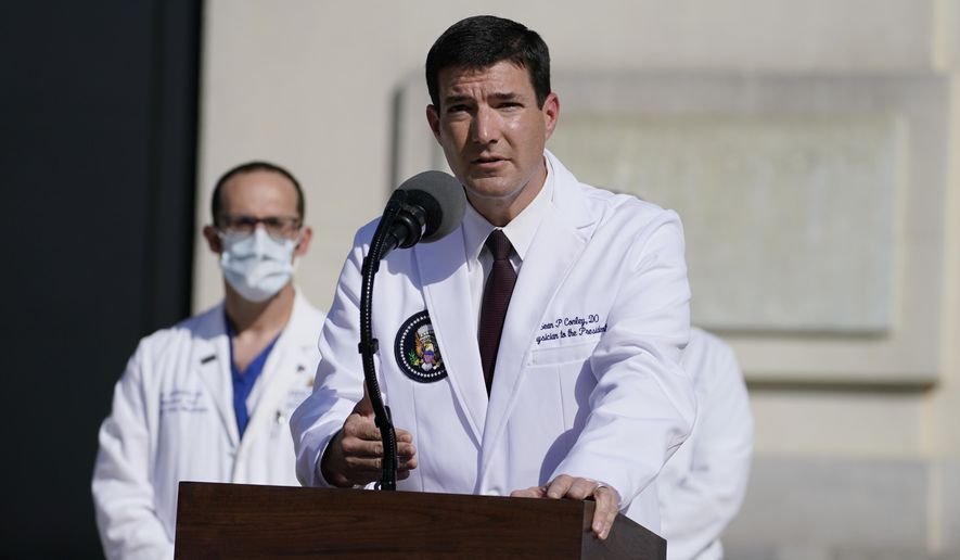In this file photo, Dr. Sean Conley, physician to President Donald Trump, talks with reporters at Walter Reed National Military Medical Center, Monday, Oct. 5, 2020, in Bethesda, Md. (AP Photo/Evan Vucci)  **FILE**