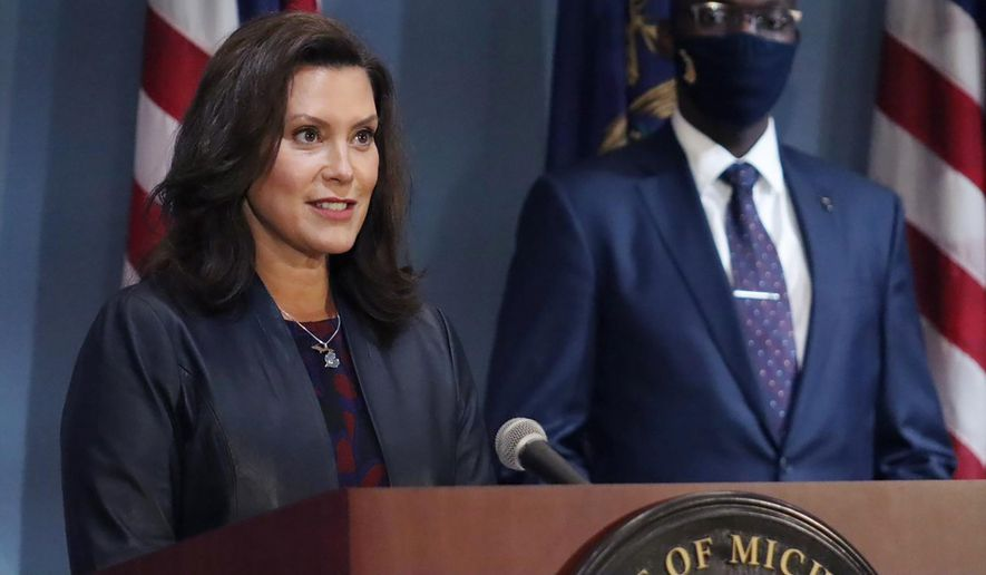 FILE - In this Wednesday, Sept. 2, 2020 file photo provided by the Michigan Office of the Governor, Gov. Gretchen Whitmer addresses the state during a speech in Lansing, Mich. Whitmer said Monday, Oct. 5, 2020, that a statewide mask requirement remains in effect despite the Michigan Supreme Court's invalidation of a law that underpins her orders to control the coronavirus pandemic. (Michigan Office of the Governor via AP, File)