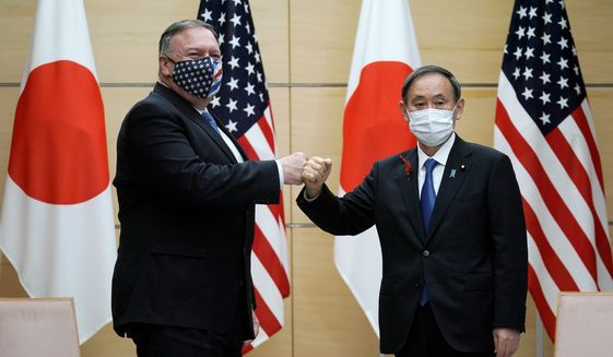 """Japanese Prime Minister Yoshihide Suga (right) said the """"Free and Open Indo-Pacific"""" security initiative is as important as ever as Secretary of State Mike Pompeo seeks help to counter China's aggressive actions. (ASSOCIATED PRESS)"""
