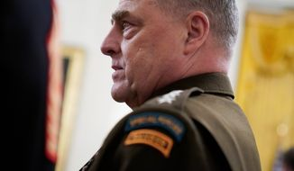 Chairman of the Joint Chiefs of Staff Gen. Mark Milley arrives for the presentation of the Medal of Honor to Army Sgt. Maj. Thomas P. Payne in the East Room of the White House on Friday, Sept. 11, 2020, in Washington. (AP Photo/Andrew Harnik) **FILE**
