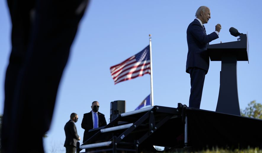 As U.S. Secret Service agents watch, Democratic presidential candidate former Vice President Joe Biden speaks at Gettysburg National Military Park in Gettysburg, Pa., Tuesday, Oct. 6, 2020. (AP Photo/Andrew Harnik)