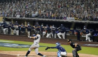 New York Yankees designated hitter Giancarlo Stanton connects for a grand slam home run against the Tampa Bay Rays during the ninth inning in Game one of a baseball American League Division Series Monday, Oct. 5, 2020, in San Diego. (AP Photo/Jae C. Hong)