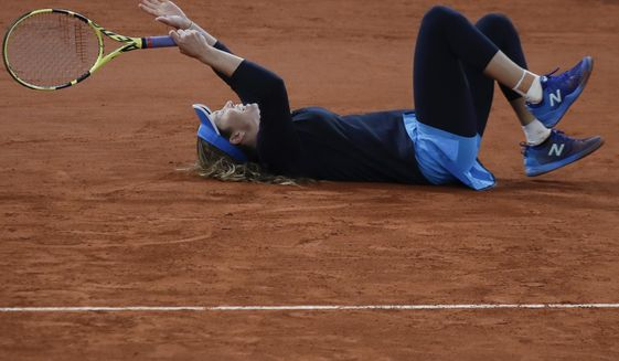 Danielle Collins of the U.S. celebrates winning her fourth round match of the French Open tennis tournament against Tunisia's Ons Jabeur in three sets, 6-4, 4-6, 6-4, at the Roland Garros stadium in Paris, France, Tuesday, Oct. 6, 2020. (AP Photo/Alessandra Tarantino)