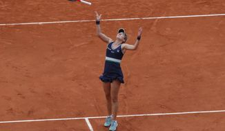 Argentina's Nadia Podoroska throws her racket in the air as she celebrates winning the quarterfinal match of the French Open tennis tournament against Ukraine's Elina Svitolina in two sets, 6-2, 6-4, at the Roland Garros stadium in Paris, France, Tuesday, Oct. 6, 2020. (AP Photo/Michel Euler)