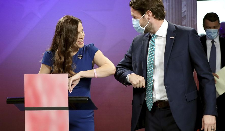 Republican challenger and state Rep. Nancy Mace and Democratic U.S. Rep. Joe Cunningham greet each other prior to their debate, Monday, Sept. 28, 2020, at the SCETV studios in Beaufort, S.C., in South Carolina's 1st Congressional District seat race. (Grace Beahm Alford/The Post And Courier via AP)
