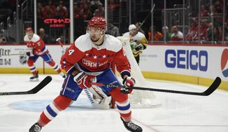 Washington Capitals defenseman Brenden Dillon (4) skates during the first period of an NHL hockey game against the Pittsburgh Penguins, Sunday, Feb. 23, 2020, in Washington. Washington re-signed Dillon to a $15.6 million, four-year contract Tuesday, Oct. 6, 2020, an announcement that came minutes after saying Michal Kempny would miss 6-8 months following surgery to repair a torn Achilles tendon. (AP Photo/Nick Wass, File)  **FILE**