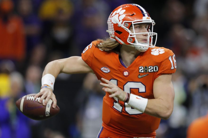 FILE - In this Jan. 13, 2020, file photo, Clemson quarterback Trevor Lawrence passes against LSU during the second half of a NCAA College Football Playoff national championship game, in New Orleans. Lawrence is on a streak of 314 pass attempts without an interception, a run dating back to last Oct. 19 when he was picked off twice at Louisville in Clemson's 45-10 victory. (AP Photo/Gerald Herbert, File)  **FILE**