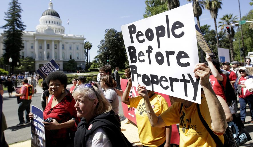 FILE - In this April 23, 2018, file photo, supporters of a rent control initiative march near the state Capitol calling for more rent control, in Sacramento, Calif. State regulators are investigating a claim by supporters of a ballot proposal to let cities expand rent control that opponents have accepted improper campaign donations. The allegations will be reviewed by the enforcement division of the Fair Political Practices Commission, which said it had made no decision about the validity of the claims. (AP Photo/Rich Pedroncelli, File)