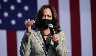 Democratic vice-presidential candidate Sen. Kamala Harris, D-Calif., speaks at a drive-in campaign event Friday, Oct. 2, 2020, in Las Vegas. (AP Photo/John Locher)