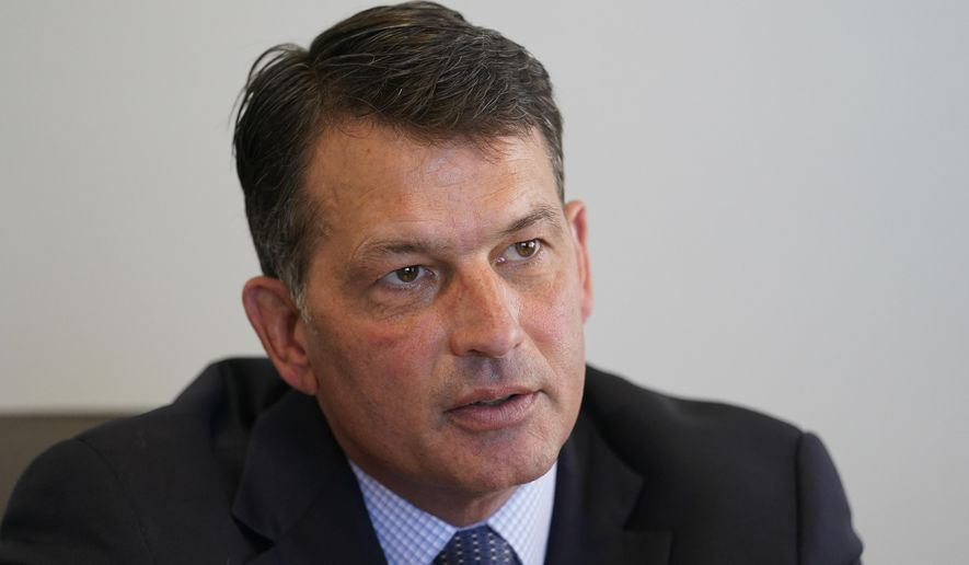 Democratic attorney general candidate Jonathan Weinzapfel responds to a question during an interview, Thursday, Aug. 20, 2020, in Indianapolis. (AP Photo/Darron Cummings)
