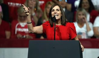 FILE - In this Feb. 19, 2020, file photo, Sen. Martha McSally, R-Ariz., speaks at a rally for President Donald Trump in Phoenix. McSally and Democratic challenger Mark Kelly meet Tuesday, Oct. 6, 2020, in what's likely to be the only debate of the campaign. (AP Photo/Rick Scuteri, File)