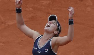 Argentina's Nadia Podoroska celebrates winning the quarterfinal match of the French Open tennis tournament against Ukraine's Elina Svitolina in two sets, 6-2, 6-4, at the Roland Garros stadium in Paris, France, Tuesday, Oct. 6, 2020. (AP Photo/Michel Euler)