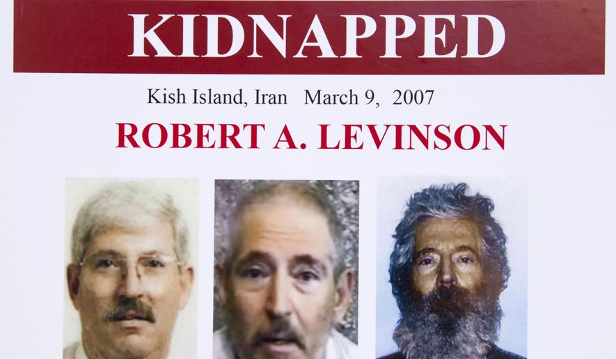 In this March 6, 2012, file photo, an FBI poster showing a composite image of former FBI agent Robert Levinson, right, of how he would look like now after five years in captivity, and an image, center, taken from the video, released by his kidnappers, and a picture before he was kidnapped, left, displayed during a news conference in Washington. A U.S. judge ordered Iran on Thursday, Oct. 1, 2020, to pay $1.45 billion to Levinson's family, who is believed to have been kidnapped by the Islamic Republic while on an unauthorized CIA mission to an Iranian island in 2007. (AP Photo/Manuel Balce Ceneta, File)