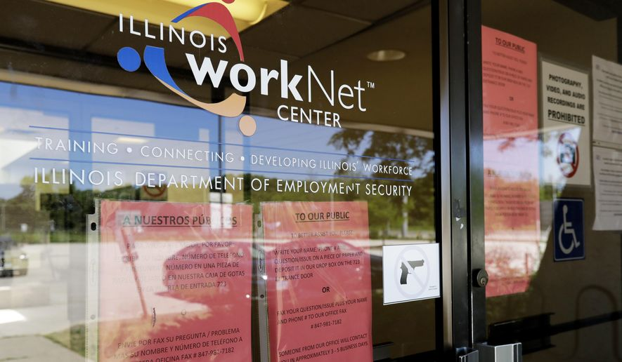 In this June 11, 2020, file photo, information signs are displayed at the closed Illinois Department of Employment Security WorkNet center in Arlington Heights, Ill. U.S. employers advertised for slightly fewer jobs in August while their hiring ticked up modestly. The Labor Department said Tuesday, Oct. 6, 2020, that the number of U.S. job postings on the last day of August dipped to 6.49 million, down from 6.70 million July. (AP Photo/Nam Y. Huh, File)