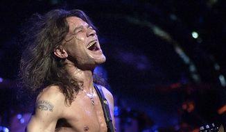In this Aug. 5, 2004, file photo, Van Halen guitarist Eddie Van Halen performs in Phoenix. Van Halen, who had battled mouth cancer, died Tuesday, Oct. 6, 2020. He was 65. (AP Photo/Tom Hood, File)