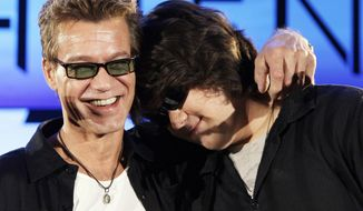 FILE - Eddie Van Halen, left, embraces his son Wolfgang Van Halen after the rock group Van Halen officially announced their North American tour during a news conference in Los Angeles on Aug. 13, 2007. Eddie Van Halen, who had battled cancer, died Tuesday, Oct. 6, 2020. He was 65. (AP Photo/Kevork Djansezian, File)