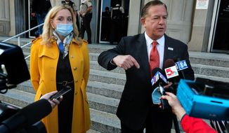 Mark McCloskey addresses the press alongside his wife Patricia on Tuesday, Oct. 6, 2020, outside the Carnahan Courthouse, in St. Louis, Mo. The couple's hearing scheduled for Tuesday was postponed until next week. The McCloskeys were charged in July with brandishing guns at protesters outside their Portland Place mansion in June. (Laurie Skrivan/St. Louis Post-Dispatch via AP)