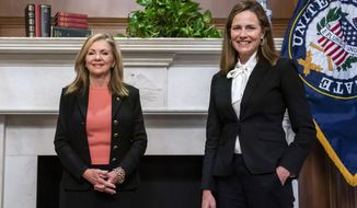 Judge Amy Coney Barrett, President Donald Trumps nominee for the U.S. Supreme Court, meets with Sen. Marsha Blackburn, R-Tenn., on Capitol Hill in Washington, Thursday, Oct. 1, 2020. (Jim Lo Scalzo/Pool via AP)