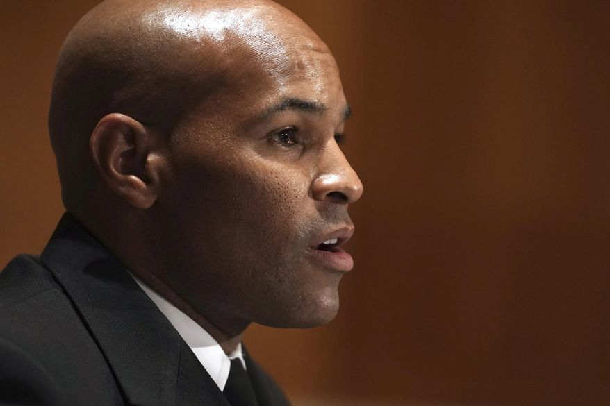 In this Sept. 9, 2020 file photo Surgeon General Jerome Adams testifies during a Senate Health, Education, Labor and Pensions Committee hearing to discuss vaccines and protecting public health during the coronavirus pandemic on Capitol Hill, in Washington. Adams was cited for being in a closed Hawaii park in August while in the islands helping with surge testing amid a spike in coronavirus cases, according to a criminal complaint filed in court. (Greg Nash/Pool via AP,File)
